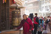 Buddhist monk near stupa Boudhanath — Stock Photo
