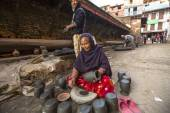 Nepalese woman working in pottery workshop. — Stock Photo
