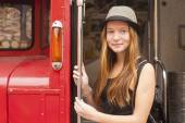 Girl near vintage red bus. — Stockfoto