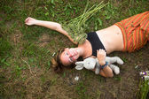Girl lying on the ground — Stock Photo