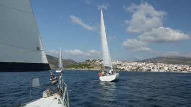 "Sailboats participate in sailing regatta ""12th Ellada Autumn 2014"" on Aegean Sea. — Stock Video"