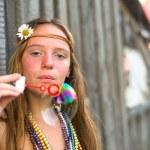 Hippie girl blows soap bubbles — Stock Photo #56474361