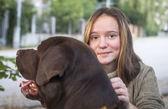 Girl with a big dog. — Stockfoto