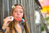Hippie girl blows soap bubbles — Stock Photo