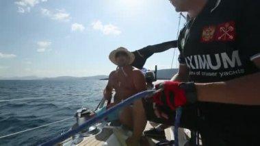 """Sailors participate in sailing regatta """"12th Ellada Autumn 2014"""" on Aegean Sea. — Stock Video"""