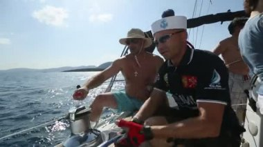 "Sailors participate in sailing regatta ""12th Ellada Autumn 2014"" on Aegean Sea. — Stock Video"
