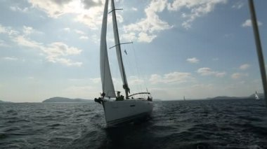 "Sailboats participate in sailing regatta ""12th Ellada Autumn 2014"" on Aegean Sea. — Stock Video"