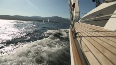 Sailing in the wind through the waves. Sailing boat shot in full HD at the Sailing in the Aegean Sea. — Stock Video
