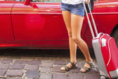 Girl with red suitcase — Stock Photo