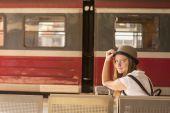 Girl waiting for train — Stock Photo