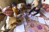 Unknown children doing homework — Stock Photo