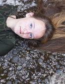 Beautiful young girl lying — Stock Photo