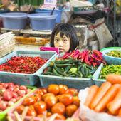 Unidentified girl child seller — Stock Photo