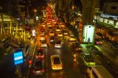 Traffic jam in city center at night — Stock Photo