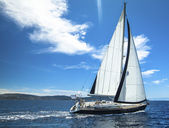 Sailing yachts with white sails — Stock Photo