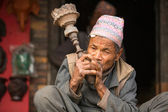 Unidentified Nepalese man smokes — Stock Photo