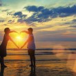 Couple holding hands in heart shape — Stock Photo #61984763