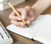 Hand writes with a pen — Stock Photo