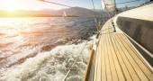 Yacht sailing towards the sunset — Stock Photo