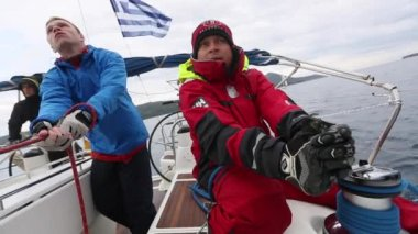 Clips set: Sailors participate in sailing regatta 12th Ellada Autumn 2014 among Greek island group in the Ionian Sea and Aegean Sea, in Cyclades and Saronic Gulf. — Stock Video