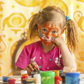 Child with a face painted — Stock Photo