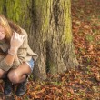 Girl in the autumn forest — Stock Photo #66720493