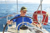 Young man skipper on  yacht. — Stock Photo