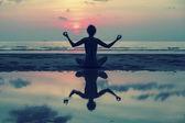 Girl doing meditation on beach — Stock Photo