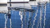 Reflection of yacht masts — Stock Photo