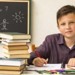 Schoolboy doing homework — Stock Photo #68925511