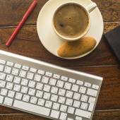 Keyboard and a Cup of coffee — Stock Photo