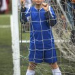 Teenager boy plays soccer — Stock Photo #70839361