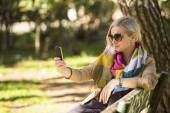 Blonde woman doing a self-portrait with smartphone — Stock Photo