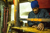 Man working in his wooden workshop. — Stock Photo