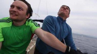 Sailors participate in sailing regatta — Stock Video