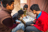 Unidentified local people playing chess — Stock Photo