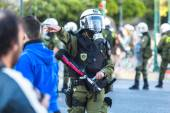 Riot police take cover — Stock Photo