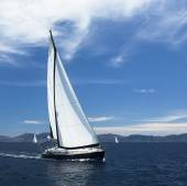 Yacht sails with beautiful cloudless sky — Stock Photo