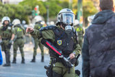 Riot police, take cover in front of the Athens University — Stock Photo