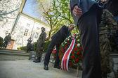 Laying flowers to the monument to Hugo Kollataj — Stock Photo