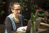 Female freelancer with a laptop — Stock Photo