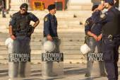 Riot police with their shields — Stock Photo