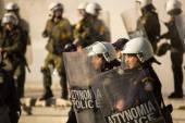 Riot police with their shields — Stockfoto