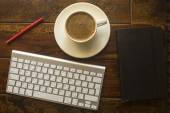 Computer keyboard, Cup of coffee on the table — Stock Photo