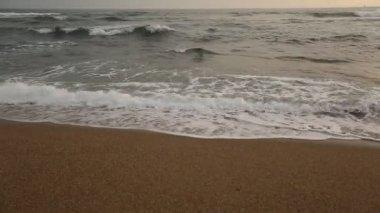 Atlantic ocean surf splashes on sunset. — Stockvideo