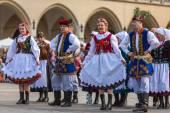 Polish folk collective on Main square — Stock Photo