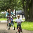 Little boy with sister ride bikes — Stock Photo #76406109
