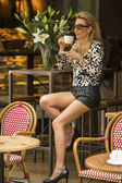 Fashionable blonde woman with cup of coffee — Stock Photo