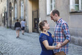 Couple in love dancing on pavement — Stock Photo
