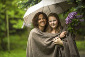 Woman with daughter under umbrella — Stock Photo